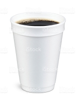 White foam cup containing coffee with bubbles on top